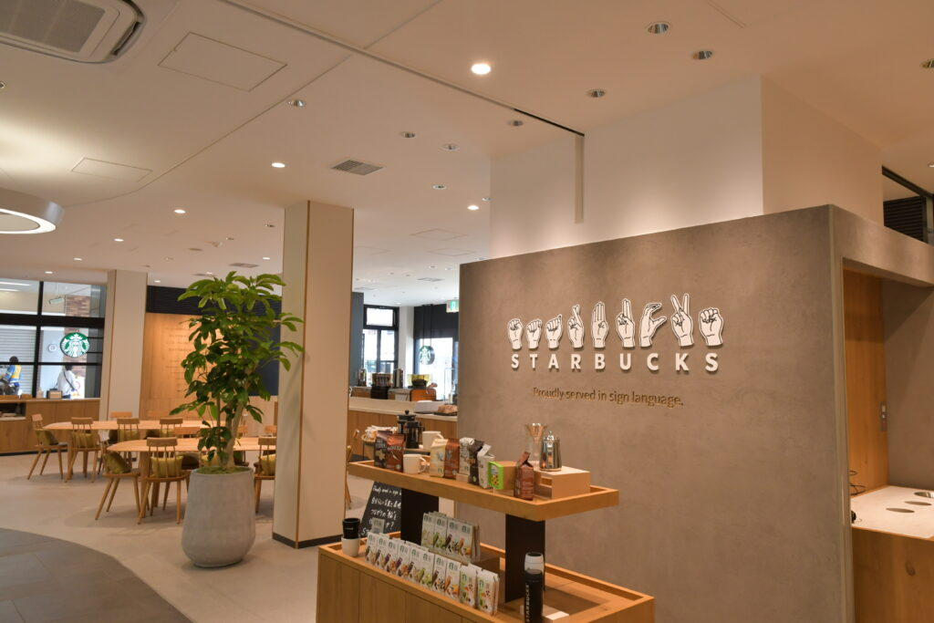 Interior of Japan's first Starbucks signing store, with Starbucks name displayed in fingerspelling