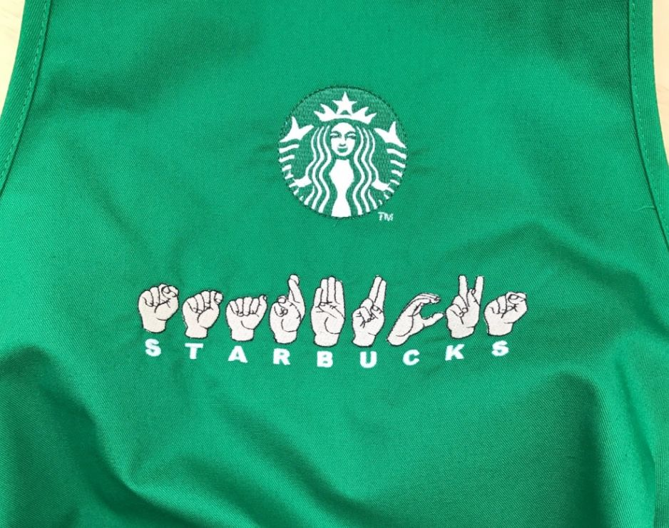 Sign Language Aprons Open Communication In Starbucks Stores